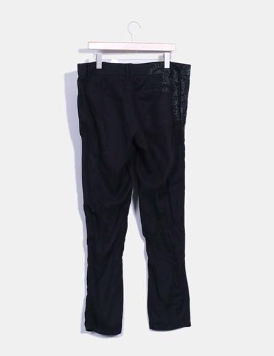 Pantalon negro print floral