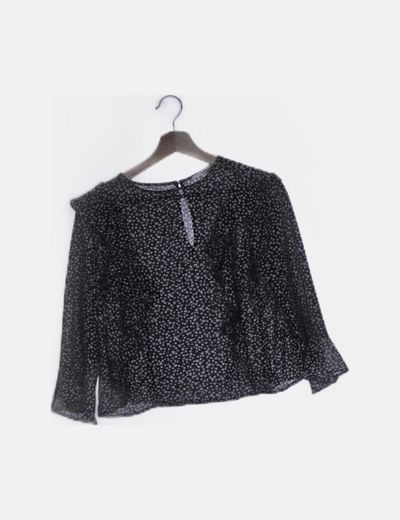Blusa negra floral detalles plisados