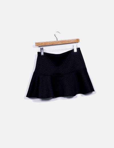 Mini falda evase negro texturizado