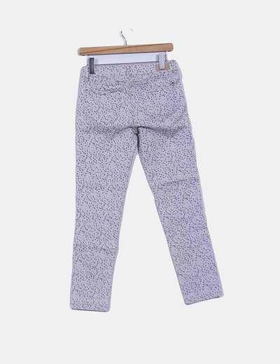 Pantalon gris con topos