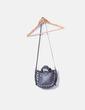 Bolso negro tachas plateadas con asa Zara