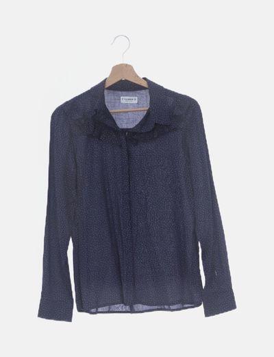 Blusa azul marina con topos y volante