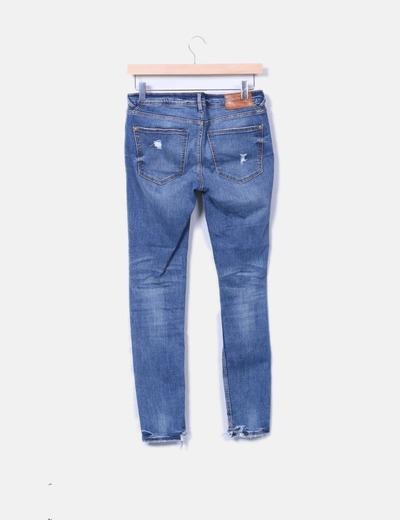 Jeans denim skinny con rotos