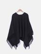 Poncho de lana negro oversize con flecos Gattiuoui