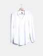 Blusa blanca con bordados Naf Naf
