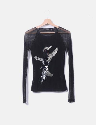 Camiseta negra semitransparente con abalorios