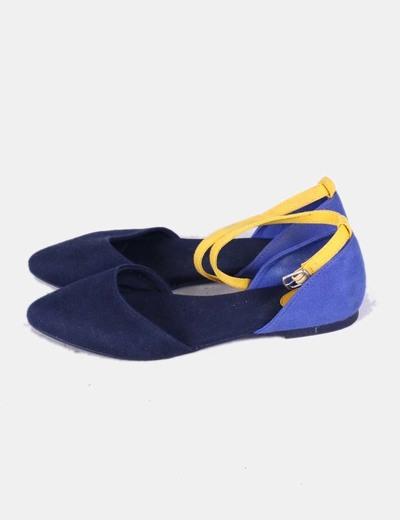 Bailarina azul marina con pulsera Benetton