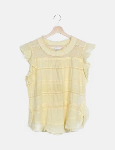 Camiseta amarilla desflecada