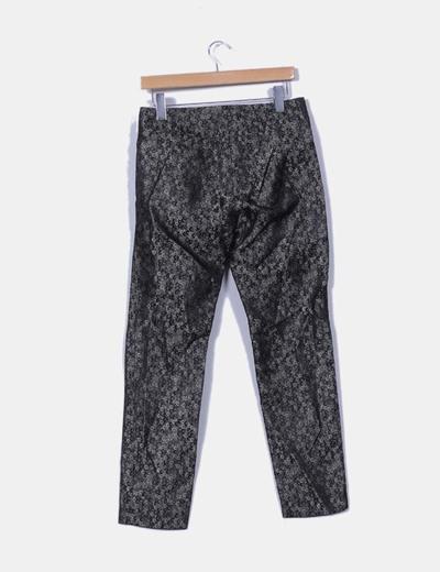 Pantalon negro y plateado estampados circulares