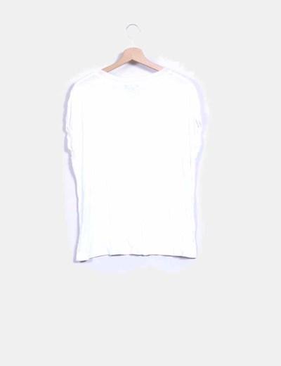 Camiseta blanca con flecos