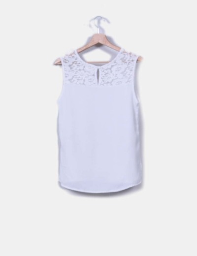 Blusa blanca combinada sin mangas