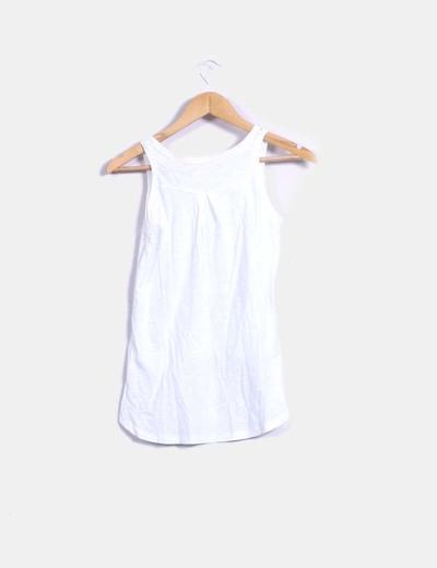 Blusa blanca combinada con paillettes