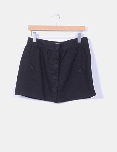 Mini falda negra con botones Bershka