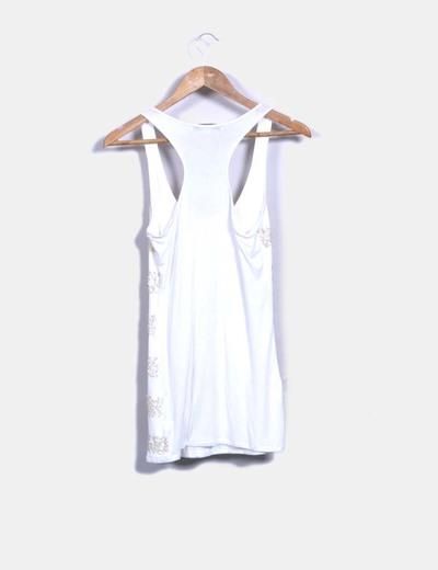 Camiseta blanca con pailettes
