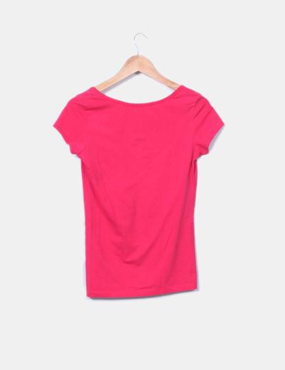 Camiseta rosa fucsia con botones