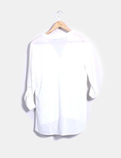 Blusa fluida blanca semi transparente