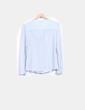 Blusa azul transparente con topos Zara