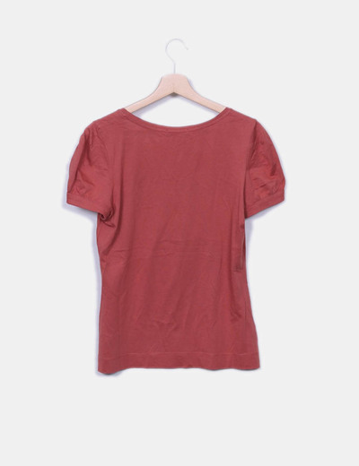 Blusa color caldera detalle lazo