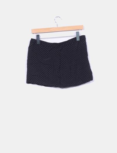 Mini falda negra con topos