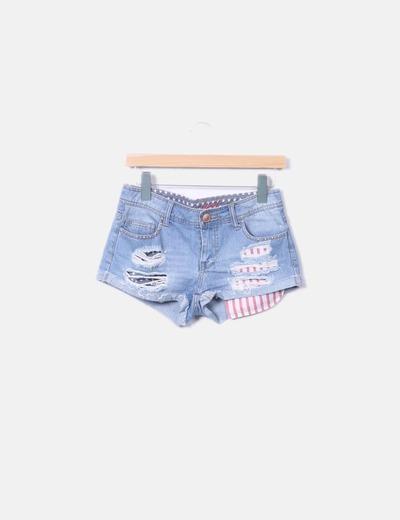 Shorts denim ripped con tachas