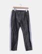 Pantalón negro y plateado estampados circulares NoName