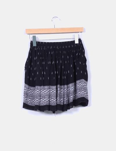 Mini falda negra estampada evase