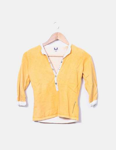 Camiseta tricot naranja detalle costura