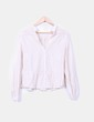 Camisa en tono crudo con encajes H&M