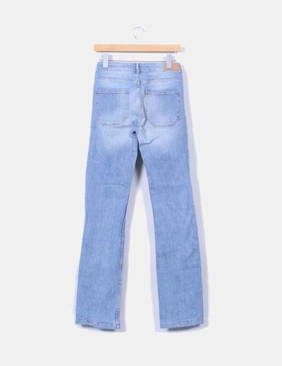 Jeans tono claro detalle bolsillos
