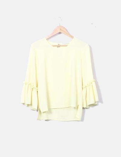 Blusa amarilla detalle mangas