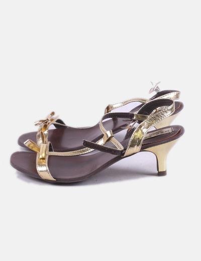 Zapato dorado con lazo