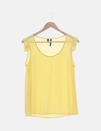 Blusa amarilla con volantes