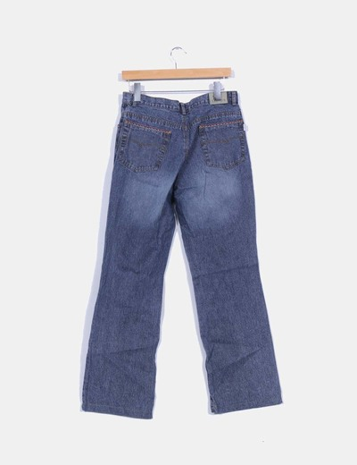 Pantalon denim con ribetes bordados