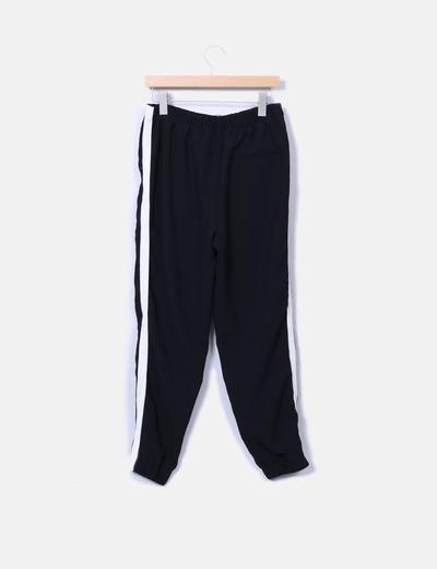 Pantalon baggy negro franja blanca