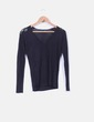 Suéter tricot negro con pedrería Zara