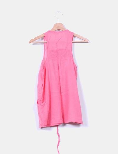 Blusa rosa con bolsillos