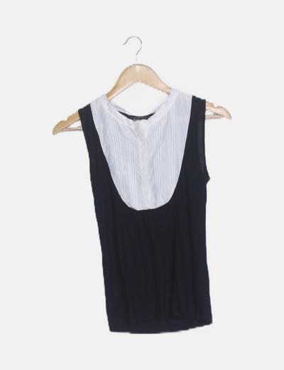 Blusa bicolor con chorreras