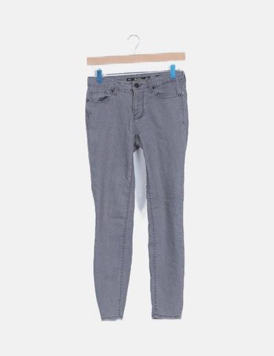 Pantalón pitillo topos gris