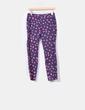 Pantalón azul marino con manchas rosas H&M