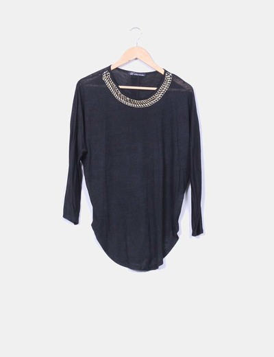 Suéter negro con gargantilla dorada L'Olive verte