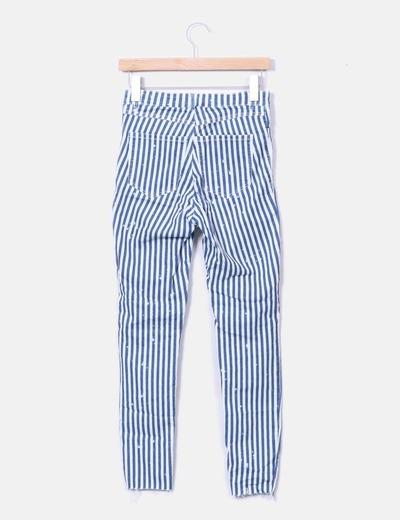 Jeans denim de rayas con rotos
