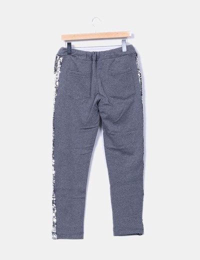 Pantalon gris felpa con pailettes