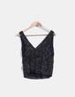 Blusa negra combinada con lentejuelas Zara