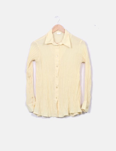 Blusa plisada amarilla