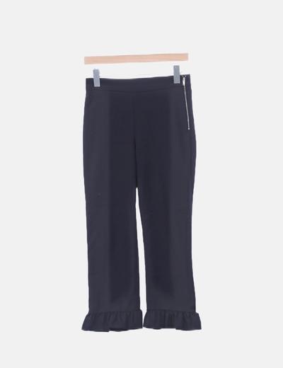 Pantalón pitillo negro volantes