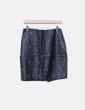Mini falda polipiel negra con tachas Ewigem
