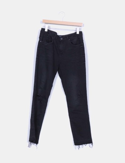 Jeans denim pitillo negro bajos ripped