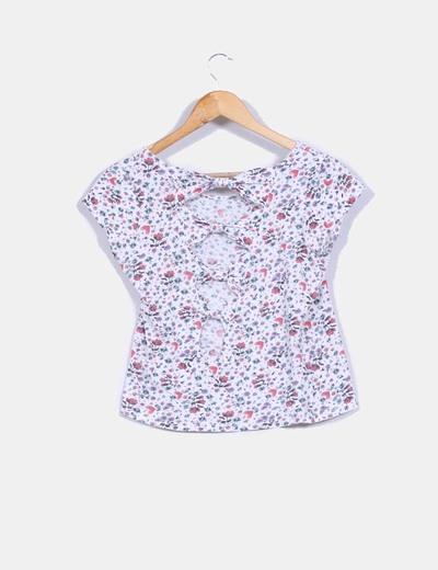 Camiseta con estampado floral y lace up en la parte trasera