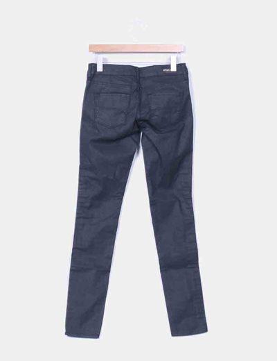 Jeans encerado negro detalle tachas