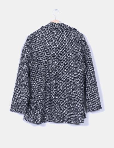 Chaqueta de lana blanca y negra jaspeada